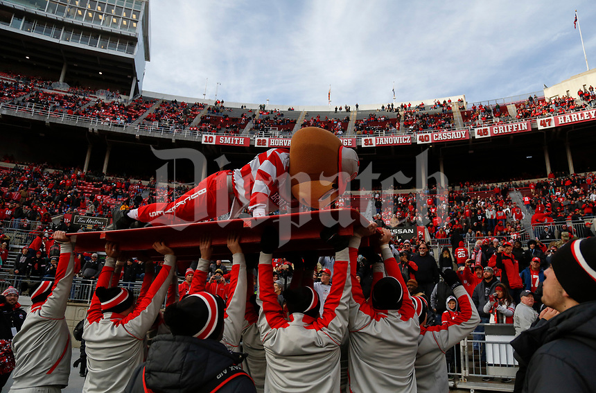 Brutus the Buckeye does push-ups during the fourth quarter of a NCAA college football game between the Ohio State Buckeyes and the Michigan State Spartans on Saturday, November 11, 2017 at Ohio Stadium in Columbus, Ohio. [Joshua A. Bickel/Dispatch]