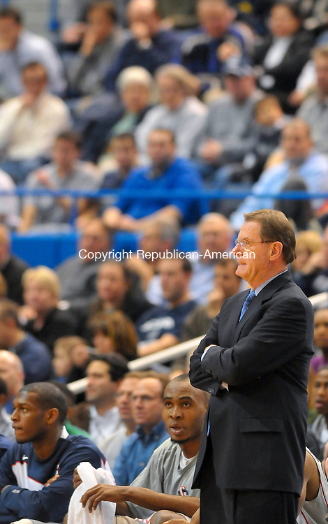 HARTFORD, CT- 20 JANUARY 2010-012010JS11--UConn Men's Basketball acting head coach George Blaney watches the action during their 75-59 win over St. John's Wednesday at the XL Center in Hartford. <br /> Jim Shannon Republican-American