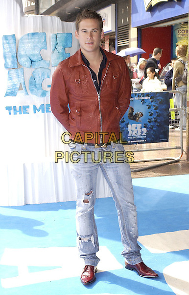 "LEE RYAN.At the UK Film Premiere of ""Ice Age 2: The Meltdown"",.Empire Cinema, Leicester Square, London, .England, April 2nd 2006..full length brown leather jacket ripped jeans pointy shoes.Ref: CAN.www.capitalpictures.com.sales@capitalpictures.com.©Can Nguyen/Capital Pictures"