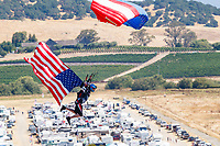 Jul 30, 2017; Sonoma, CA, USA; A skydiver parachutes in with an American flag prior to the NHRA Sonoma Nationals at Sonoma Raceway. Mandatory Credit: Mark J. Rebilas-USA TODAY Sports