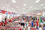 August 20, 2011. Chapel Hill, NC.. UNC students brought to the local Super Target by company chartered buses check out at the store cashiers. Target hired the buses and staged sales to encourage students to buy items in the store that they might need for their dorm rooms.. Many companies have increased their efforts to reach the youth market by employing popular college students to raise the awareness of the brand by peer to peer marketing on campus' around the country.
