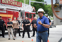 NWA Democrat-Gazette/CHARLIE KAIJO Carroll Electric Safety and Training Coordinator Greg Motzko talks to Bentonville first responders about how to safely handle emergency situations where power lines are involved during a safety demonstration, Monday, June 3, 2019 at the Bentonville Fire Department Station 1 in Bentonville<br />