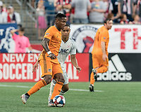 FOXBOROUGH, MA - JUNE 29: Romell Quioto #31 dribbles as Brandon Bye #15 pressures during a game between Houston Dynamo and New England Revolution at Gillette Stadium on June 29, 2019 in Foxborough, Massachusetts.