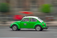 Mexico City, Mexico, October 2005. Volkswagen beetle taxis race through the streets.  Mexico is a colorful country with remnants of many ancient civilisations, mixed cultures, and two oceans. Photo by Frits Meyst/Adventure4ever.com