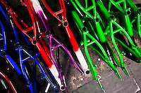 Painted and cured bike framesets are seen on the floor of a small scale bicycle factory in Bogota, Colombia, 10 April 2013. Due to the strong, vibrant cycling culture in Colombia, with cycling being one of the two most popular sports in the country, dozens of bike workshops and artisanal, often family-run bicycle factories were always spread out through the Colombian cities. However, growing import of cheap bicycles and components from China during the last decade has led to a significant decline in domestic bicycle production. Traditional no-name bike manufacturers are forced to close down their factories, struggling to survive in the competitive bicycle market.
