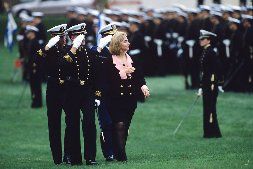 First Lady Hillary Clinton reviews a military troop formation while attending the christening of the USS Columbia submarine in New London, CT.