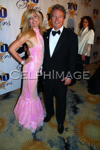 SANDI SCHULTZ, JOHN SAVAGE. Arrivals to the 20th Annual Night of 100 Stars Oscar Viewing Gala at the Beverly Hills Hotel. Beverly Hills, CA, USA. March 7, 2010.