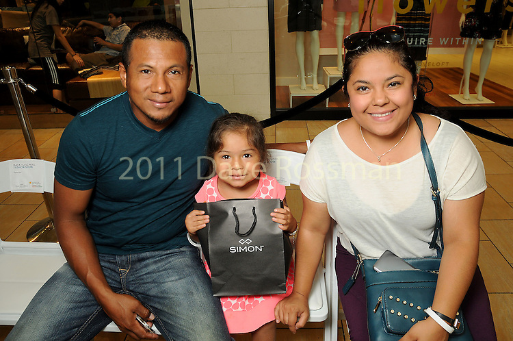From left: Jorge Cruz, Sophia Cruz,4, and Viry Flores at the M.D. Anderson Back to School Fashion show at the Galleria Saturday Aug. 06,2016.(Dave Rossman Photo)