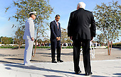 United States President Barack Obama flanked by Defense Secretary Robert Gates and Chairman of the Joint Chiedf of Staff Michael Mullen participate in a wreath laying ceremony and moment of silence at the Pentagon Memorial to mark the 9th anniversary of the terrorist attacks, in Arlington, Virginia, Saturday, September 11, 2010..Credit: Olivier Douliery - Pool via CNP