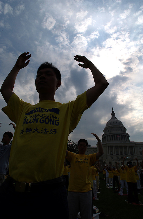 FalunGong7_072203 -- Falun Gong practitioners during a rally to commemorate the fourth anniversary of China's persecution against Falun Gong. The rally was held on the West Front of the U.S. Capitol..