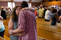 "Christine Kane, of Pembroke, Mass., embraces her son Kevin Kane during the last service at St. Frances Xavier Cabrini Church in Scituate, Mass., on Sun., May 29, 2016. The two represent the second and third generations of their family to attend the church. Members of the congregation have been holding a vigil for more than 11 years after the Archdiocese of Boston ordered the parish closed in 2004. For 4234 days, at least one member of Friends of St. Frances X. Cabrini has been at the church at all times, preventing the closure of the church. May 29, 2016, was the last service held at the church after members finally agreed to leave the building after the US Supreme Court decided not to hear their appeal to earlier an Massachusetts court ruling stating that they must leave. The last service was called a ""transitional mass"" and was the first sanctioned mass performed at the church since the vigil began."