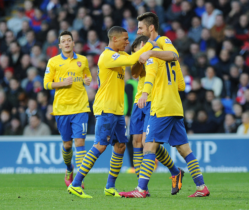 Arsenal's Aaron Ramsey celebrates scoring the opening goal with team mates Olivier Giroud and Kieran Gibbs<br /> <br /> Photo by Ashley Crowden/CameraSport<br /> <br /> Football - Barclays Premiership - Cardiff City v Arsenal - Saturday 30th November 2013 - Cardiff City Stadium - Cardiff<br /> <br /> &copy; CameraSport - 43 Linden Ave. Countesthorpe. Leicester. England. LE8 5PG - Tel: +44 (0) 116 277 4147 - admin@camerasport.com - www.camerasport.com
