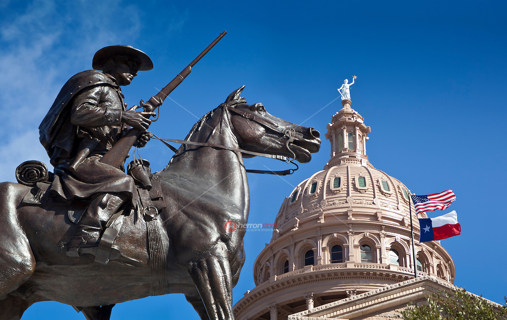 Texas Ranger Statue guards the Goddess of Liberty Statue in front of Texas State Capitol Building.