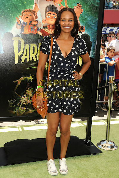 """Samantha Mumba .""""ParaNorman"""" Los Angeles Premiere held at AMC CityWalk Stadium 19 Theatre, Universal City, California, USA..August 5th, 2012.full length white black print dress brown satchel sneakers trainers hand on hip cleavage  birds swallows .CAP/ADM/BP.©Byron Purvis/AdMedia/Capital Pictures."""