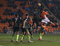 Bristol Rovers' Ellis Harrison heads clear from Blackpool's Armand Gnanduillet <br /> <br /> Photographer Stephen White/CameraSport<br /> <br /> The EFL Sky Bet League One - Blackpool v Bristol Rovers - Saturday 13th January 2018 - Bloomfield Road - Blackpool<br /> <br /> World Copyright &copy; 2018 CameraSport. All rights reserved. 43 Linden Ave. Countesthorpe. Leicester. England. LE8 5PG - Tel: +44 (0) 116 277 4147 - admin@camerasport.com - www.camerasport.com