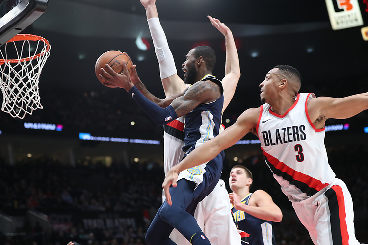 Denver Nuggets guard Will Barton (5) slithers past Portland Trail Blazers guard CJ McCollum (3) in the first half at Moda Center.<br /> Photo by Jaime Valdez