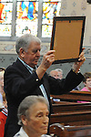 Johnny Gregory carries one of the gifts that was brought to the altar at the mass in St Mary's church for the last 3 remaining nuns from Mercy Convent who are leaving. Photo: www.colinbellphotos.com