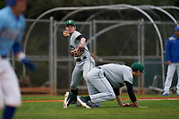 Dartmouth Big Green third baseman Justin Murray (5) throws to first base during a game against the Indiana State Sycamores on February 21, 2020 at North Charlotte Regional Park in Port Charlotte, Florida.  Indiana State defeated Dartmouth 1-0.  (Mike Janes/Four Seam Images)