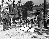 U.S. Marines guarding three captured North Koreans, ca. 1950.  Sgt. W. M. Compton.  (Marine Corps)<br /> Exact Date Shot Unknown<br /> NARA FILE #:  127-N-A3597<br /> WAR &amp; CONFLICT BOOK #:  1490