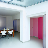 A series of panels extends the full length of the basement ranging from aubergine throught to pale pink and fuschia