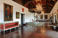 Great Hall of the Governors, in the Museo de las Casas Reales, or Museum of the Royal Houses, in the Colonial Zone of Santo Domingo, capital of the Dominican Republic, in the Caribbean. This room served as a throne room and reception room. It has a gilded wooden ceiling and is lined with portraits of the governors. The museum was opened in 1973 to celebrate the history and culture of the Spanish inhabitants of the colony, and is housed in a 16th century colonial palace originally serving as governor's office and Audiencia Real or Royal Court. Santo Domingo's Colonial Zone is listed as a UNESCO World Heritage Site. Picture by Manuel Cohen