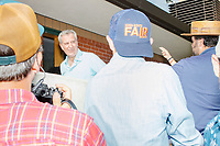 Democratic presidential candidate and NYC mayor Bill de Blasio greets people near the media tent at the Iowa State Fair in Des, Moines, Iowa, on Sun., Aug. 11, 2019.