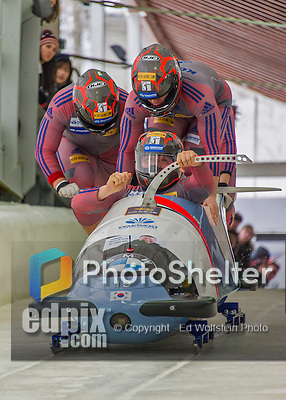 9 January 2016: South Korean pilot Yunjong Won leads his 4-man team as they push off their first run of the day at the BMW IBSF World Cup Bobsled Championships at the Olympic Sports Track in Lake Placid, New York, USA. Won's team came in 14th for the day, with a 2-run combined time of 1:51.37. Mandatory Credit: Ed Wolfstein Photo *** RAW (NEF) Image File Available ***