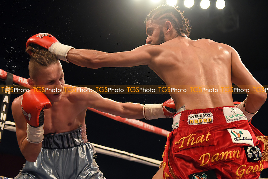 Prince Patel (red shorts) defeats David Koos during a Boxing Show at the Harrow Leisure Centre, Harrow, England on 30/10/2015
