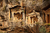 The Hellenistic temple fronted Tombs of Kaunos,  4th - 2nd cent. B.C , just outside the archaeological site of Kounos on the oposite side of the Calbys river from Dalyan, Turkey. Kaunos is on the border of Lycia & Caria and the Kaunos rock tombs differ slightly form Lycian tombs in that the rock surrounding them has been carved away to maje almost free standing temple buildings.