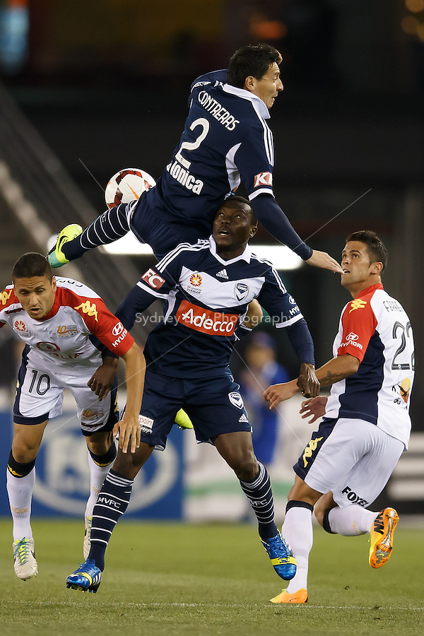 Chilean player Pablo CONTRERAS of the Victory flies for a header in the round seven match between Melbourne Victory and Adelaide United in the Australian Hyundai A-League 2013-24 season at Etihad Stadium, Melbourne, Australia.<br /> This image is not for sale. Please visit zumapress.com for image licensing.