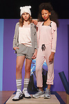 Models pose in outfits from the Katie J collection during the petitePARADE fashion show at Children's Club in the Jacob Javits Center in New York City on February 25, 2018.