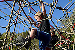 Children play on a $25,000 jungle gym at Riverfront Park funded by Mayor Lonnie Hendrix in Hyden, Kentucky on Tuesday, October 10, 2013. Mayor Hendrix had to go to Washington, D.C. in order to get money for the playground.  Photo by Leah Klafczynski