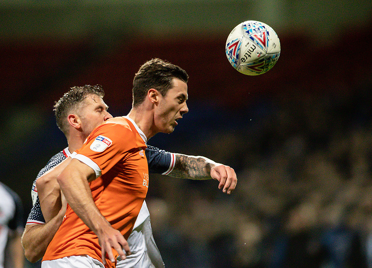 Bolton Wanderers' Daryl Murphy competing with Blackpool's Ben Heneghan (right) <br /> <br /> Photographer Andrew Kearns/CameraSport<br /> <br /> The EFL Sky Bet League One - Bolton Wanderers v Blackpool - Monday 7th October 2019 - University of Bolton Stadium - Bolton<br /> <br /> World Copyright © 2019 CameraSport. All rights reserved. 43 Linden Ave. Countesthorpe. Leicester. England. LE8 5PG - Tel: +44 (0) 116 277 4147 - admin@camerasport.com - www.camerasport.com