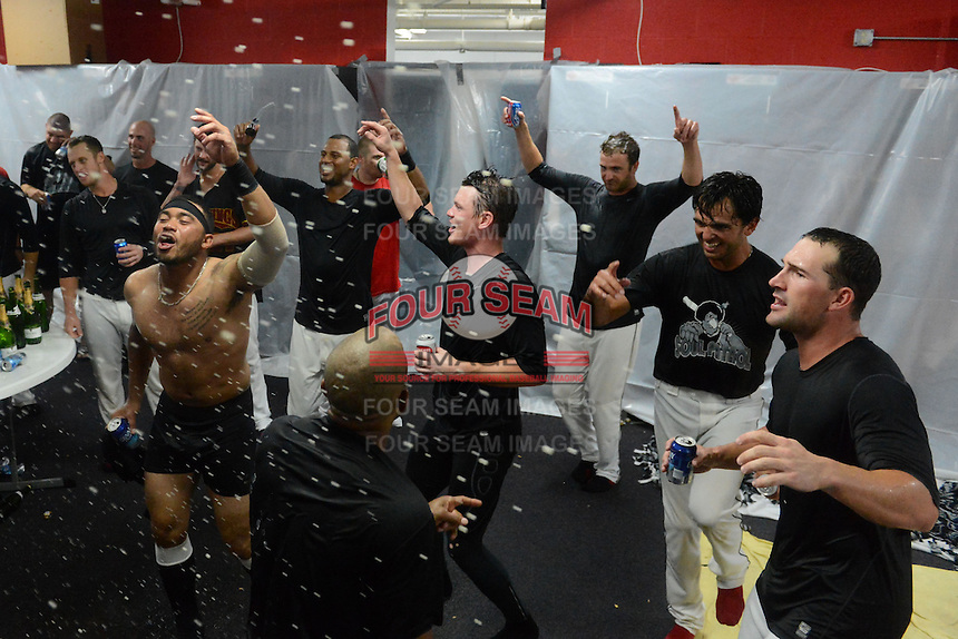 Rochester Red Wings players including Eric Farris (no shirt), Aaron Hicks, James Beresford celebrate in the locker room after defeating the Scranton Wilkes Barre RailRiders on September 2, 2013 at Frontier Field in Rochester, New York to clinch the International League Wild Card Playoff spot.  (Mike Janes/Four Seam Images)