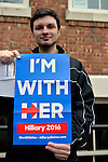 Port Washington, New York, USA. April 11, 2016. RRYAN CONNELLY, 20, of Lindenhurst, holding an I'M WITH HER Hillary 2016 poster, is waiting on line to attend a Hillary Clinton, Democratic presidential primary leading candidate, discussion on gun violence prevention with Representative Steve Israel, and activists who lost family members due to shootings. Hillary Clinton, the leading Democratic presidential primary candidate, had several Long Island events scheduled this day, and the New York presidential primary is April 19.