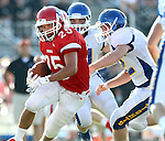 SIOUX FALLS, SD - SEPTEMBER 7:  Caden Quintanilla #25 from Lincoln scampers past the defense of O'Gorman in the third quarter of their game at the 2013 Presidents Bowl at Howard Wood Field. (Photo by Dave Eggen/Inertia)