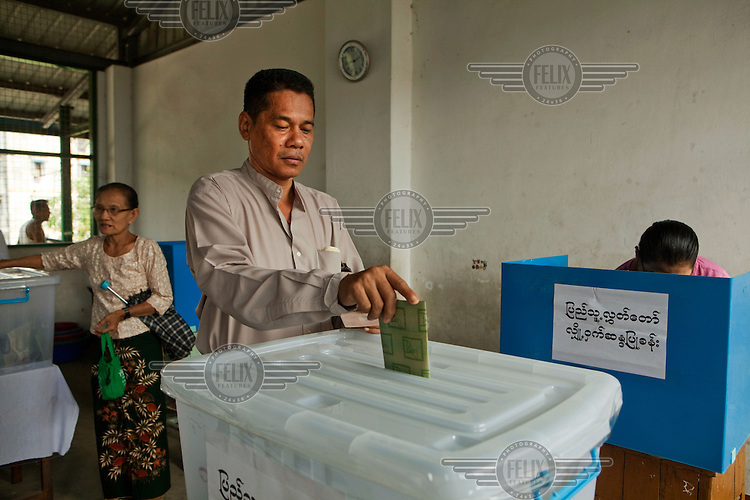 People vote in by-elections in Yangon.