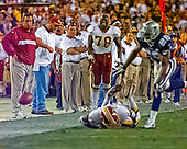 Washington Redskins defensive end Bruce Smith (78) watches third quarter action against the Dallas Cowboys at FedEx Field in Landover, Maryland on Monday, September 18, 2000.  At Smith's immediate left is Redskins head trainer Bubba Tyrer.  The Cowboys won the game 27 - 21.<br /> Credit: Arnie Sachs / CNP