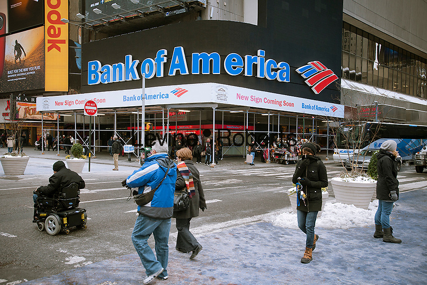 The Bank of America illuminated sign in Times Square is dark, surrounded by a sidewalk shed that announces the eminent arrival of a new improved illuminated sign, seen on Sunday, January 22, 2012. The sign, which was originally for Fleet Bank, has appeared in countless news photos to illustrate the bank. (© Richard B. Levine)