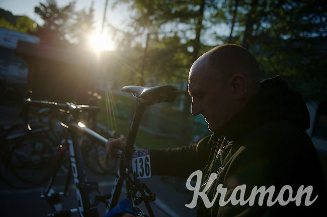 2013 Giro d'Italia.stage 10..Lotto-Belisol mechanic Jean-Pierre Christiaens works past sundown to get the bikes clean and ready for the next day/stage