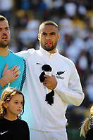 NZ capotain Winston Reid sings the national anthem before the 2018 FIFA World Cup Russia first-leg playoff football match between the NZ All Whites and Peru at Westpac Stadium in Wellington, New Zealand on Saturday, 11 November 2017. Photo: Dave Lintott / lintottphoto.co.nz