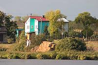 House on shore of lake across from city park.  Rawa Mazowiecka  Central Poland