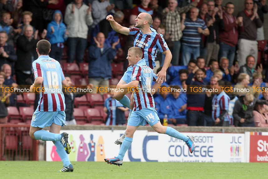 David Mirfin of Scunthorpe United (5) celebrates scoring the opening goal - Scunthorpe United vs Dagenham and Redbridge  at the Glanford Park Stadium - 17/08/13 - MANDATORY CREDIT: Dave Simpson/TGSPHOTO - Self billing applies where appropriate - 0845 094 6026 - contact@tgsphoto.co.uk - NO UNPAID USE