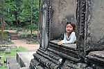 A Cambodian girl seen at Angkor Wat site in Siem Reap. Many children spend their day begging or selling at Angkor Wat, a World Heritage site that attracts large numbers of tourists.