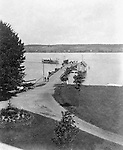 Lakewood NY: View of the Kent House boat dock and pier from the Hotel - 1901.  A Chautauqua Lake touring boar arriving at the pier. Photographs taken during a church field trip to Chautauqua Institution in New York (Lake Chautauqua). The Stewart family and friends visited Chautauqua during 1901 to hear Stewart relative, Dr. S.H. Clark  speak at the institute. Alice Brady Stewart chaperoned and Brady Stewart came along to photograph the trip.  The Gallery provides a glimpse of how the privileged and church faithful spent summers at Lake Chautauqua at the turn of the century.