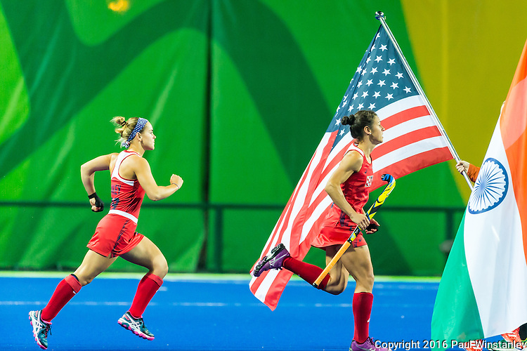 Caitlin van Sickle #28 of United States and Alyssa Manley #29 of United States run out for the national anthem before the USA vs India women's Pool B game at the Rio 2016 Olympics at the Olympic Hockey Centre in Rio de Janeiro, Brazil.