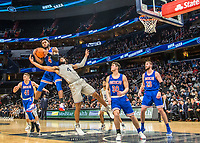 WASHINGTON, DC - DECEMBER 28: Jamir Harris #4 of American collects a rebound over Jagan Mosely #4 of Georgetown. during a game between American University and Georgetown University at Capital One Arena on December 28, 2019 in Washington, DC.