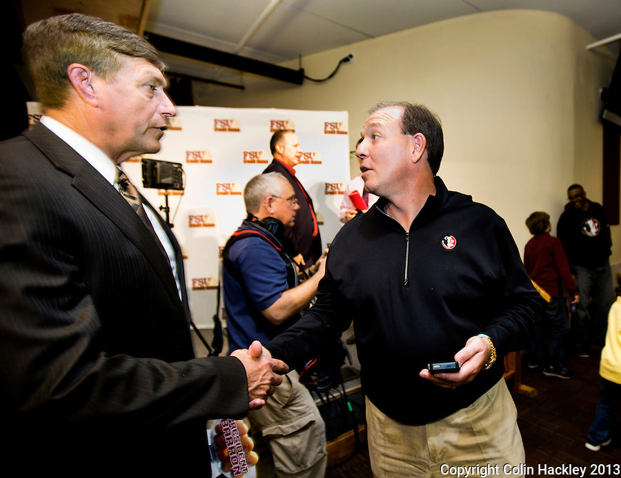 TALLAHASSEE, FLA. 2/6/13-FSUSIGNDAY020613 CH-Florida State University Athletic Director Randy Spetman, left, congratulates Head Coach Jimbo Fisher on the 2013 football recruiting class after the Seminole's national signing day War Party, Feb. 6, 2013 in Tallahassee..COLIN HACKLEY PHOTO