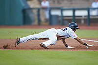 Robert Javier (33) of the Pulaski Yankees dives back towards first base during the game against the Danville Braves at Calfee Park on June 30, 2019 in Pulaski, Virginia. The Braves defeated the Yankees 8-5 in 10 innings.  (Brian Westerholt/Four Seam Images)