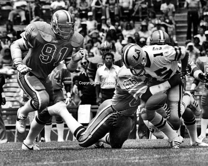Oakland Invaders vs Los Angeles Express 1983<br />qb Mike Rae is sacked &amp; fumbles hit by #86 Cedrick Hardman and #91 Monte Bennett. (photo Ron Riesterer/photoshelter.